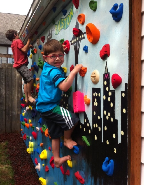 hunter on climbing wall